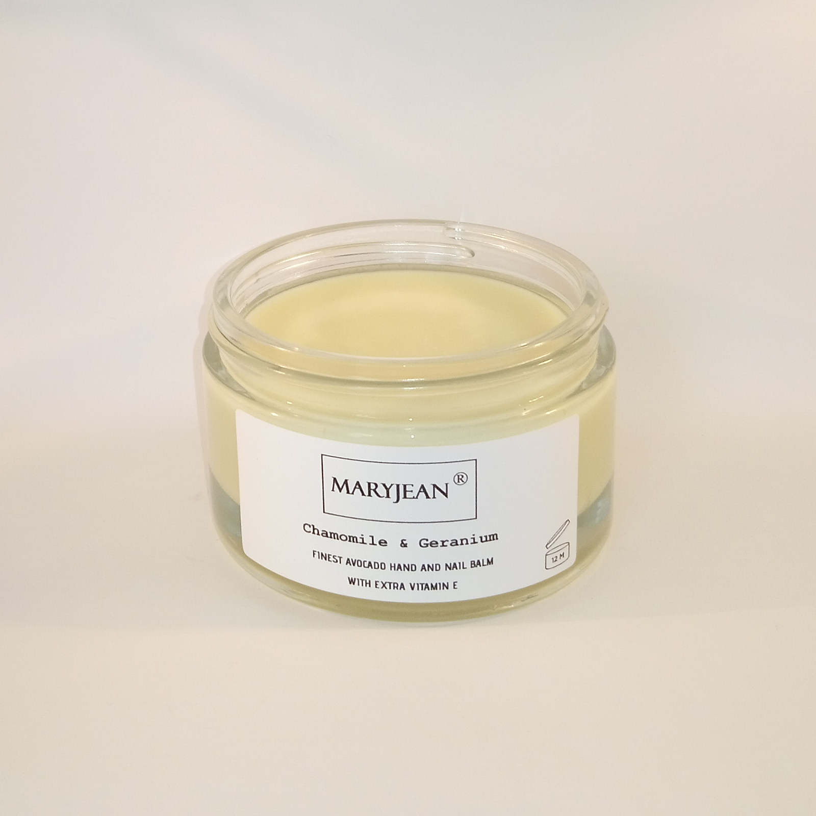 Avocado Hand and Nail Chamomile Geranium Balm with extra Vitamin E A natural organic balm designed to ease stress on hands and nails resulting in improved appearance and less aged skin fewer wrinkles and dull nails